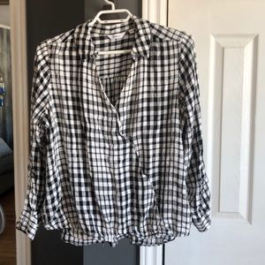 Wrap blouse with snaps. Hi/lo